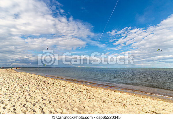 Beach by the sea on a beautiful sunny day. - csp65220345