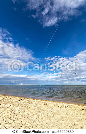 Beach by the sea on a beautiful sunny day. - csp65220339