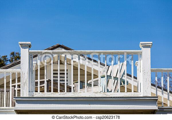 Beach Chair and Balcony Needing Paint - csp20623178