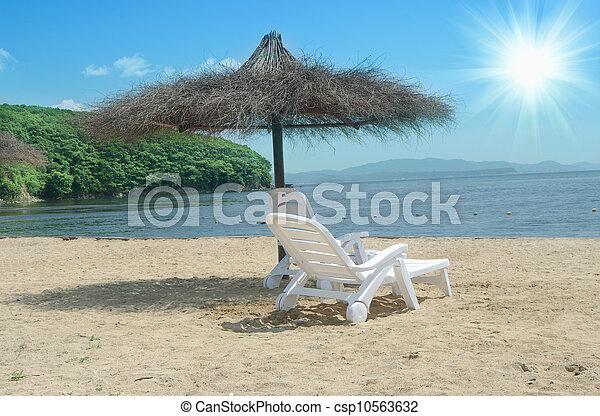 Beach chair and umbrella - csp10563632