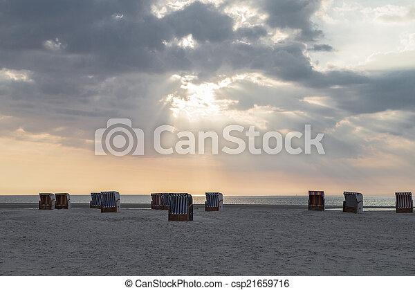 Beach chairs at sunset - csp21659716
