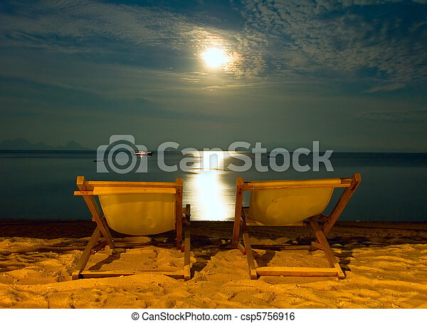 beach chairs at tropical resort - night scene - csp5756916