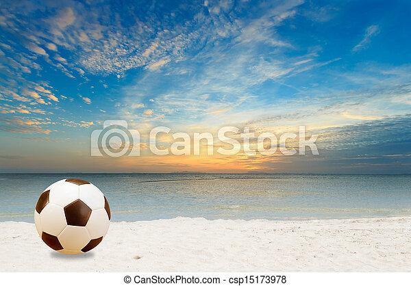 Beach football at dusk - csp15173978