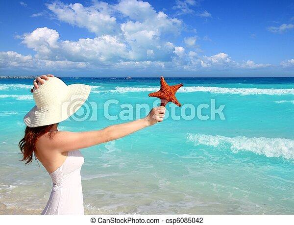 beach hat woman starfish in hand tropical Caribbean - csp6085042