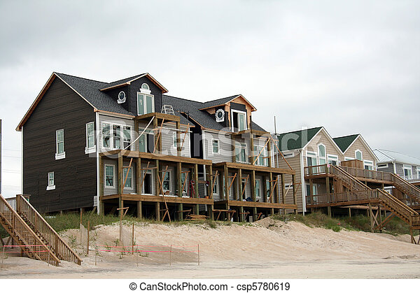 Beach home reconstruction after hurricane damage - csp5780619
