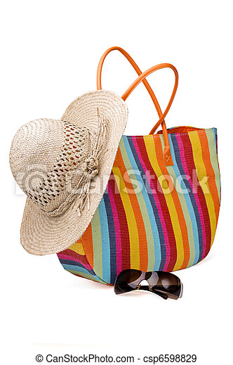 Beach items: colorful striped bag, sunglasses and straw hat - csp6598829