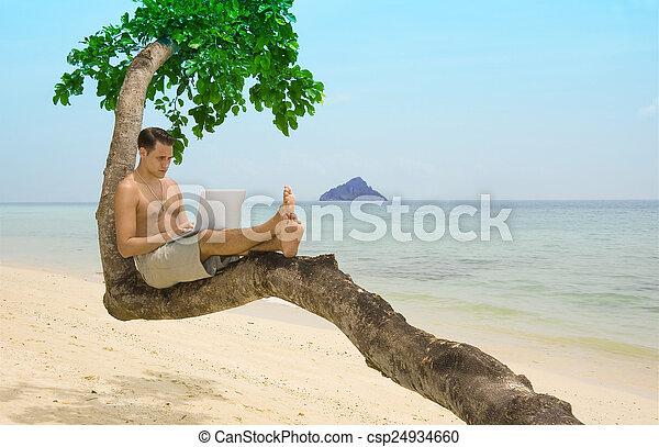 Beach laptop vacation - csp24934660
