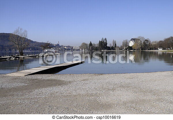 Beach of Albigny and pontoon on Annecy lake with view of the city - csp10016619