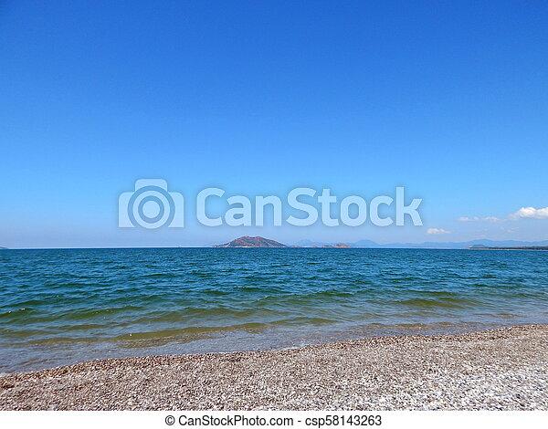 Beach of the Aegean Sea in Fethiye, Turkey - csp58143263