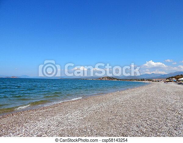 Beach of the Aegean Sea in Fethiye, Turkey - csp58143254