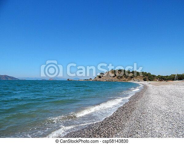 Beach of the Aegean Sea in Fethiye, Turkey - csp58143830