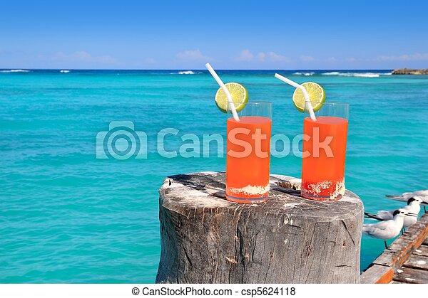 beach orange cocktail in Caribbean turquoise sea - csp5624118