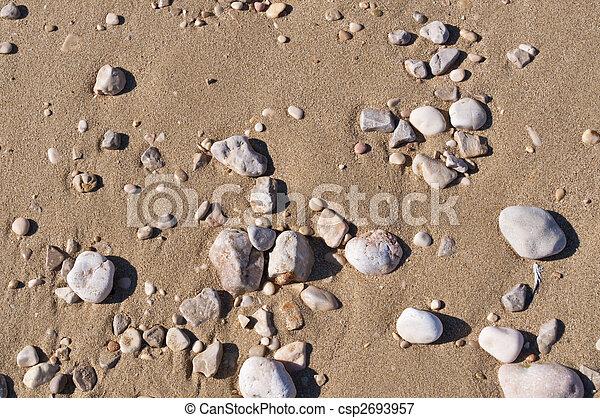 Beach sand/stones background - csp2693957
