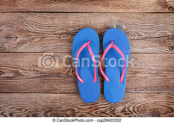 beach slippers on the old board - csp28403302