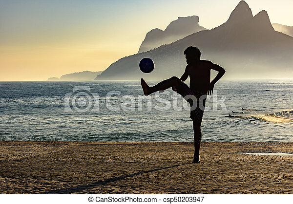 Beach soccer at sunset - csp50203947