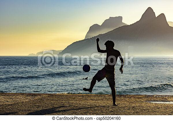 Beach soccer sunset - csp50204160