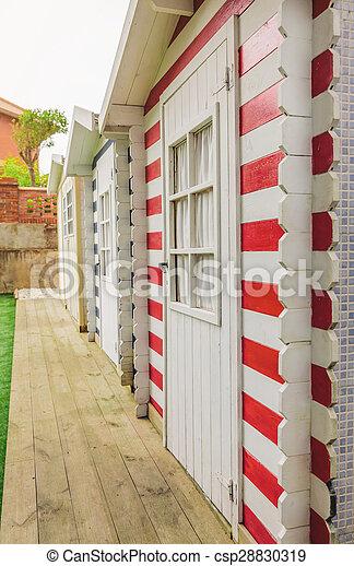 Beach striped huts in a home garden - csp28830319