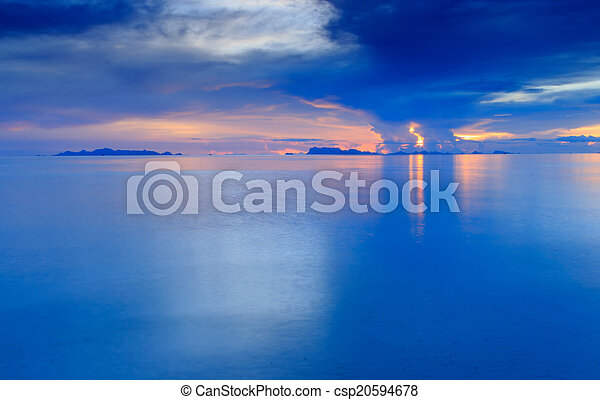 Beach sunset, Long exposure dramatic tropical sea and sky at dusk - csp20594678