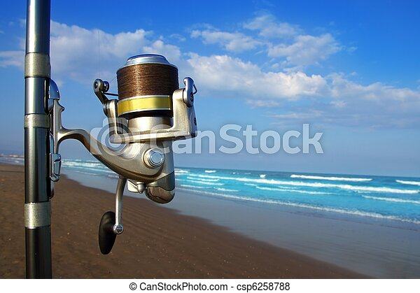 Beach surfcasting spinning fishing reel and rod - csp6258788