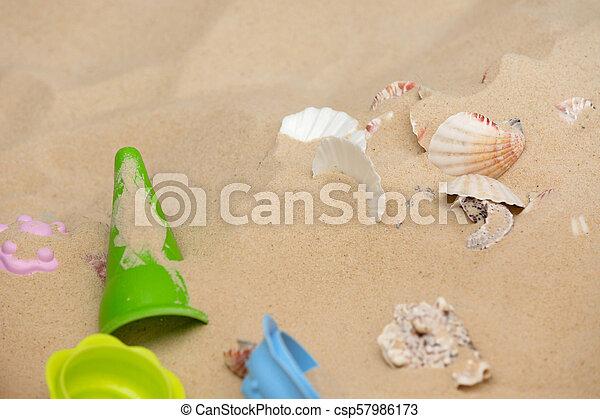 Beach Toys In The Sand - csp57986173