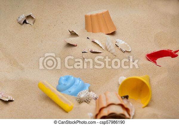 Beach Toys In The Sand - csp57986190