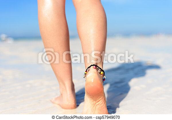 Sexy feet on beach