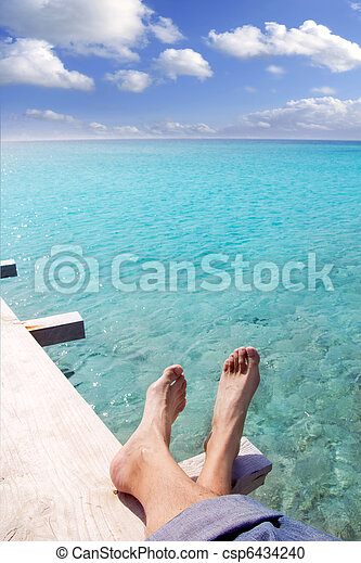 beach turquoise tourist feet relaxed on tropical pier - csp6434240