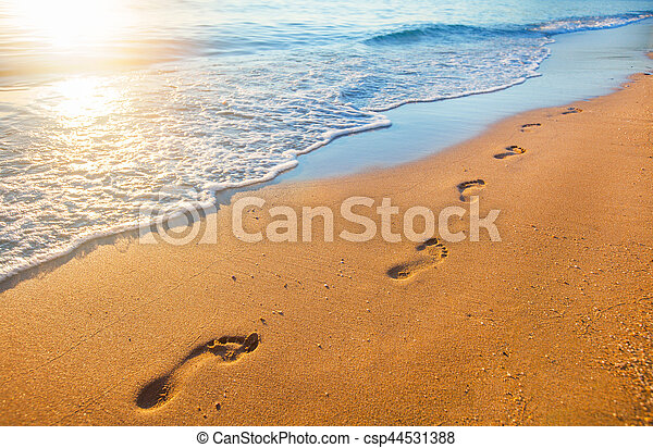 beach, wave and footprints at sunset time - csp44531388