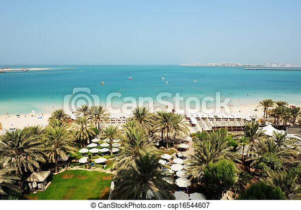 Beach with a view on Jumeirah Palm man-made island, Dubai, UAE - csp16544607