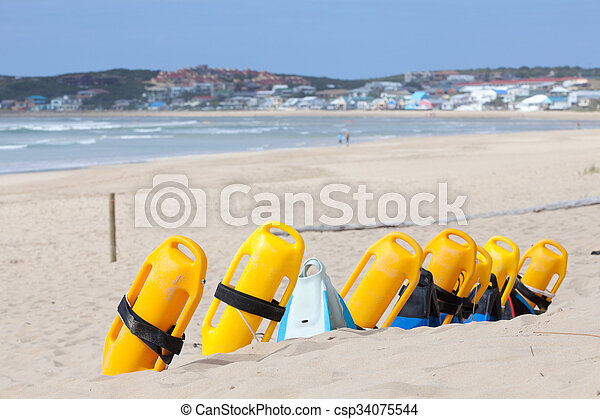 Beach with lifesaving flotation devices - csp34075544