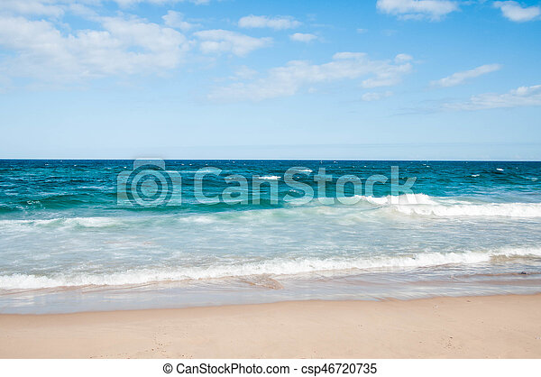 Beach with waves on a sunny day - csp46720735