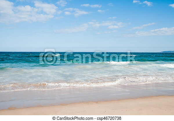 Beach with waves on a sunny day - csp46720738