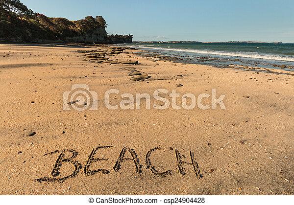 Beach written in sand  - csp24904428