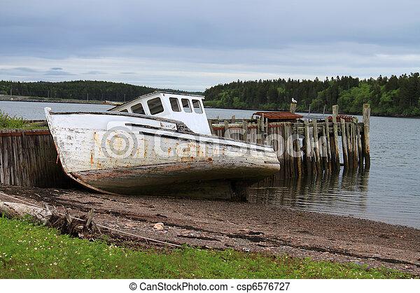 Beached Maritime fishing boat - csp6576727