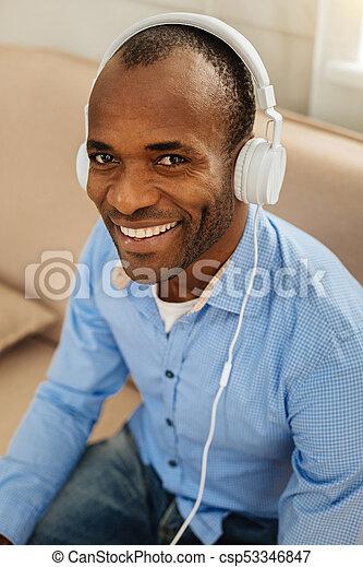 Beaming Man Listening To Music