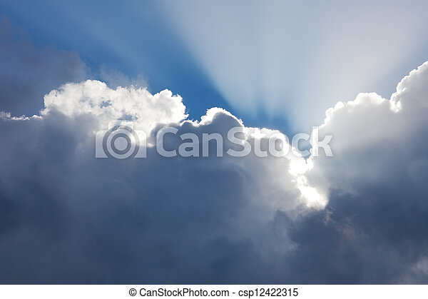 beams of the sun which are making the way through clouds. Beautiful sky as background - csp12422315