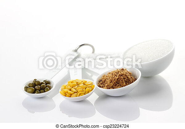 Beans in measuring spoons on white background - csp23224724