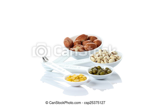 Beans in measuring spoons on white background - csp25375127