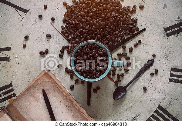Beans on antique clocks. - csp46904318