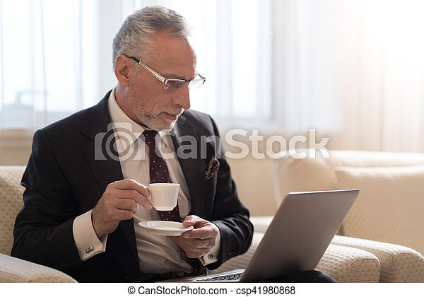 Bearded businessman working with the laptop - csp41980868