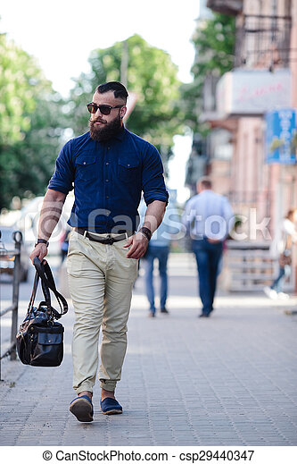 bearded man goes and listens to music - csp29440347