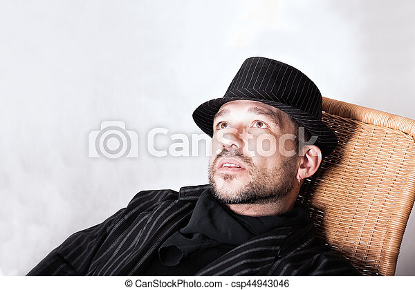 Bearded Man With Pierced Ear In Black Hat - csp44943046