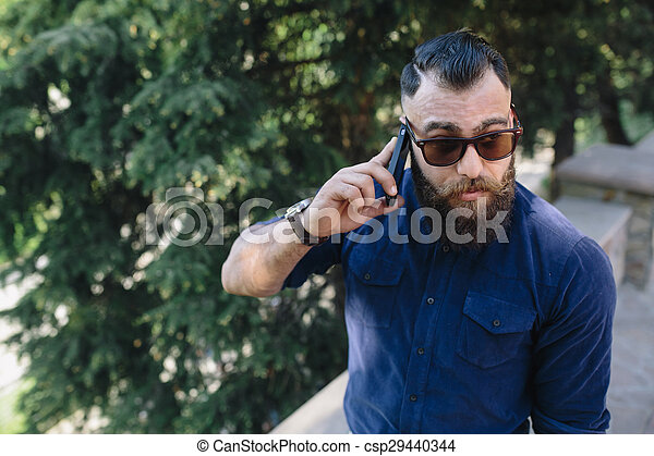 bearded speaks by phone - csp29440344
