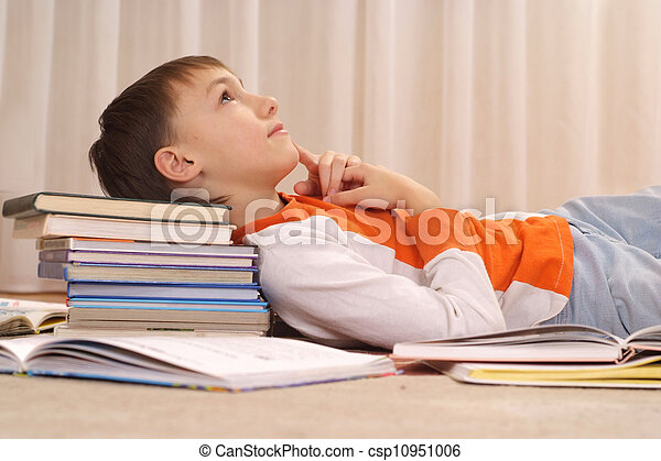 Beauteous boy does homework - csp10951006