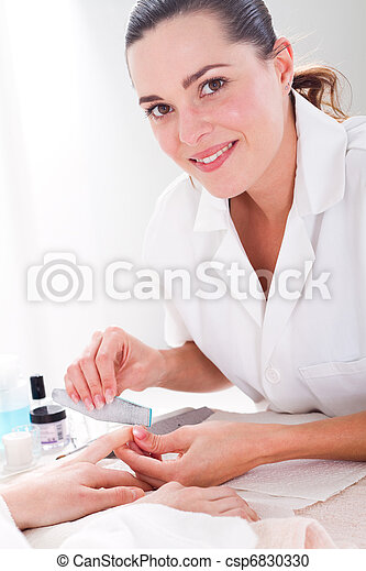 beautician applying manicure - csp6830330