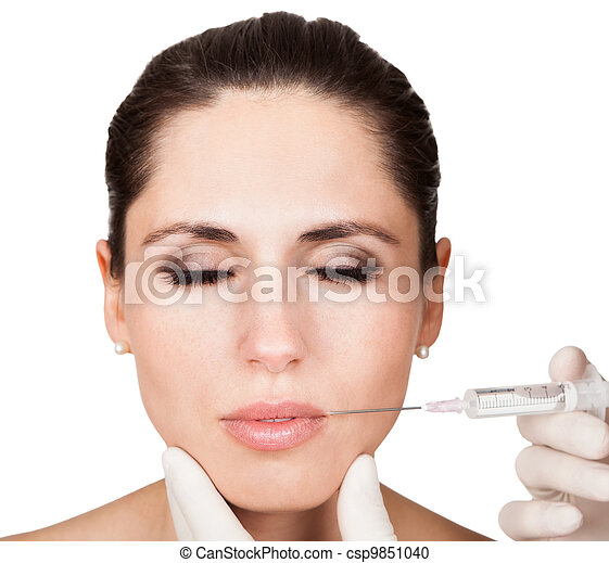 Beautician doing face injection to woman - csp9851040