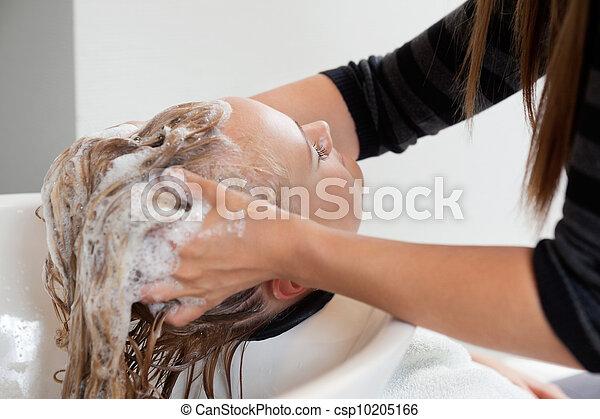 Beautician Washing Hair Of Female Customer - csp10205166