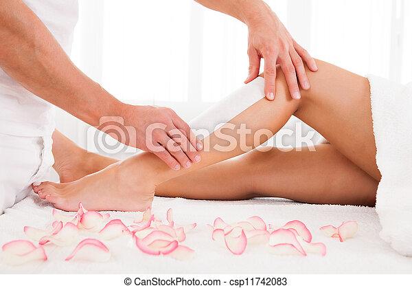 Beautician waxing a woman leg - csp11742083