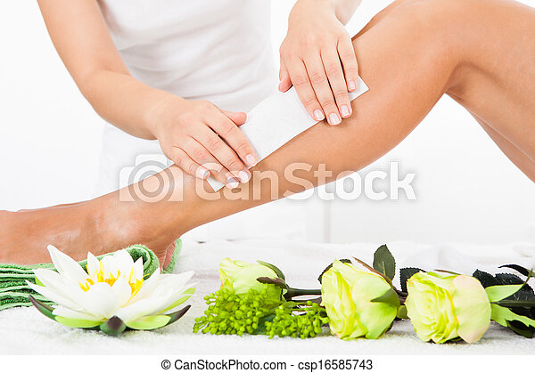 Beautician Waxing A Woman's Leg - csp16585743