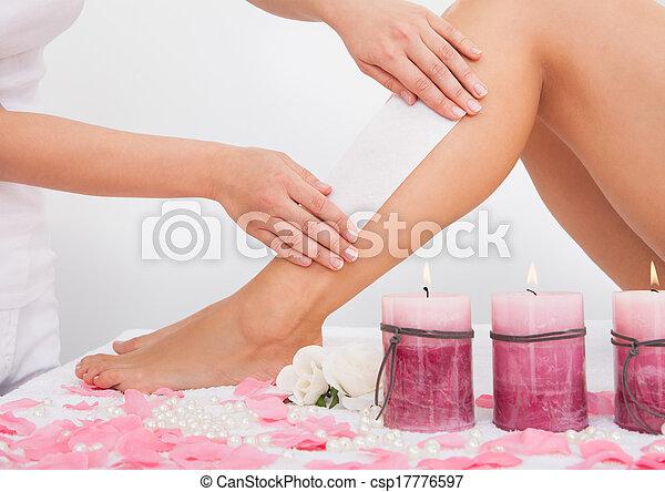 Beautician Waxing A Woman's Leg - csp17776597